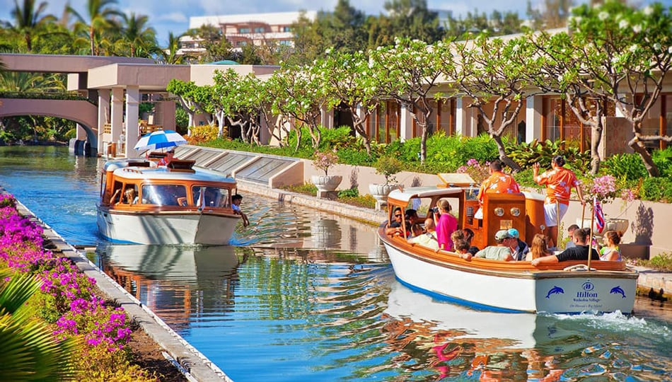 Canal Boats Ferry Guests Around the Hilton Waikoloa Village Resort