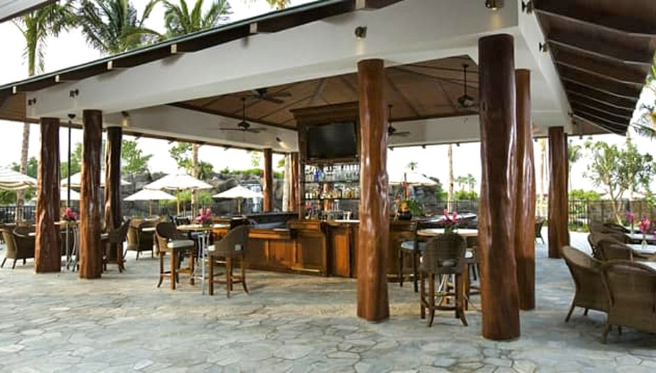 Kings Land by Hilton pool bar and outdoor dining area