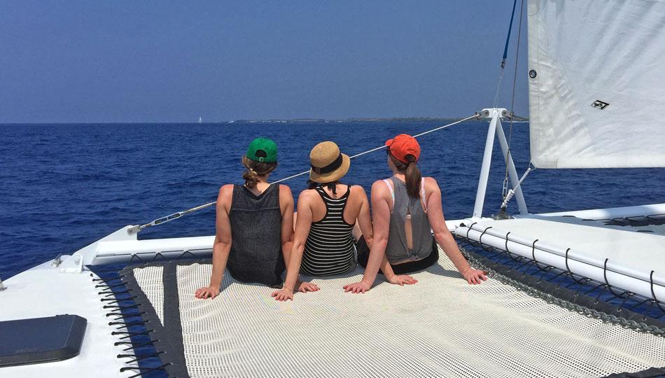 Paradise Sailing Catamaran - Girls Sitting on Front Net