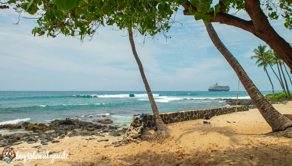 Honl's Beach with surfers, waves and a cruise ship in the background