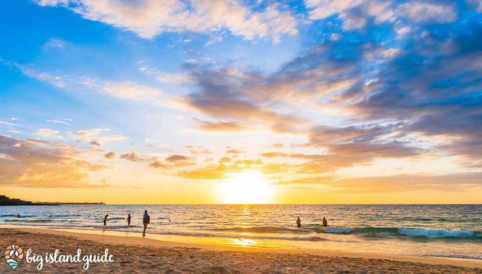 People Playing in the Waves at Sunset on Hapuna Beach