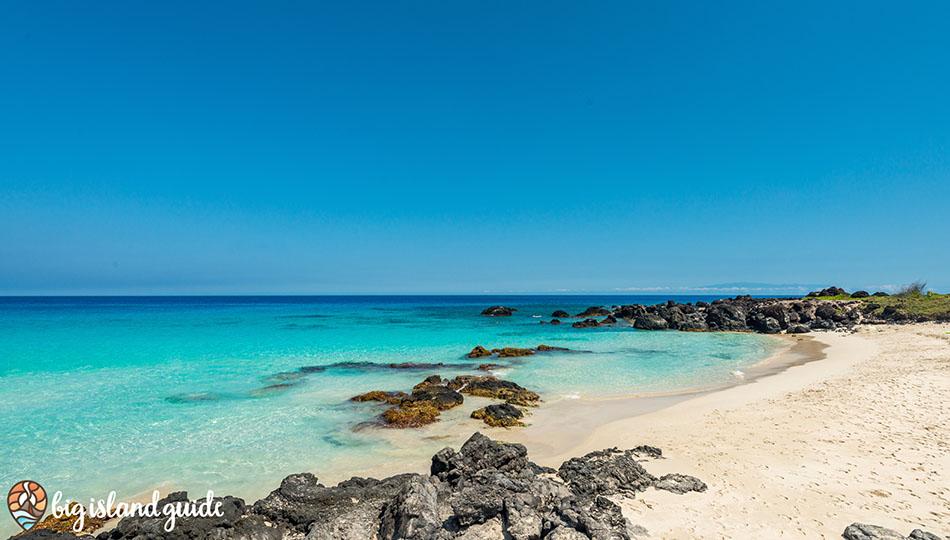 Beautiful white sand Maniniowali Beach at Kua Bay on a calm morning