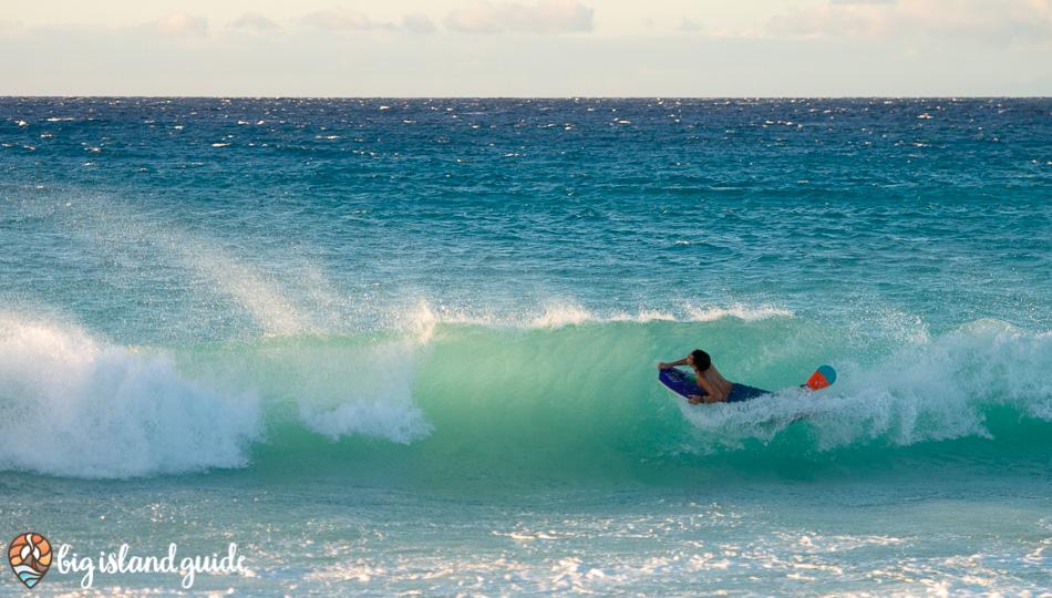 riding waves at Maniniowali Beach at Kua Bay