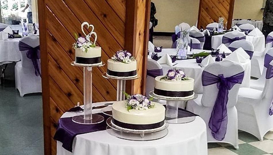 Nani Mau Garden Wedding Reception Area with purple decorations