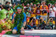2018 Ironman World Champion Patrick Lange gives a shaka at the finish line.